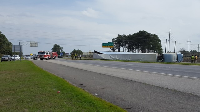 Crews work to move overturned 18-wheeler from interstate