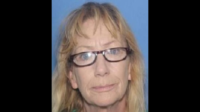 NY woman arrested after police find a body on farm land in AR