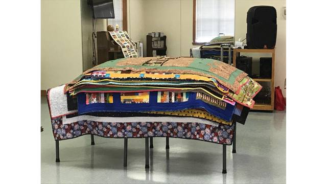The North Louisiana Quilters Guild presents over 70 handmade quilts to CASA